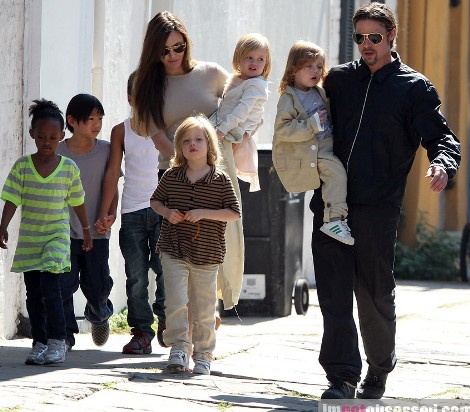 "#7011151 The Jolie-Pitt family headed out in New Orleans, Louisiana to do some grocery shopping at a local market on March 20, 2011. Angelina has brought all six children to visit their dad Brad Pitt while he works on his latest project ""Cogan's Trade"". Maddox, Pax, Zahara and Shiloh walked while the twins Knox and Vivienne hitched a ride from mom and dad who were all smiles while out and about on a lovely sunny day. Brad and Angelina waved to fans as they strolled the street to and from the market.   Fame Pictures, Inc - Santa Monica, CA, USA - +1 (310) 395-0500"
