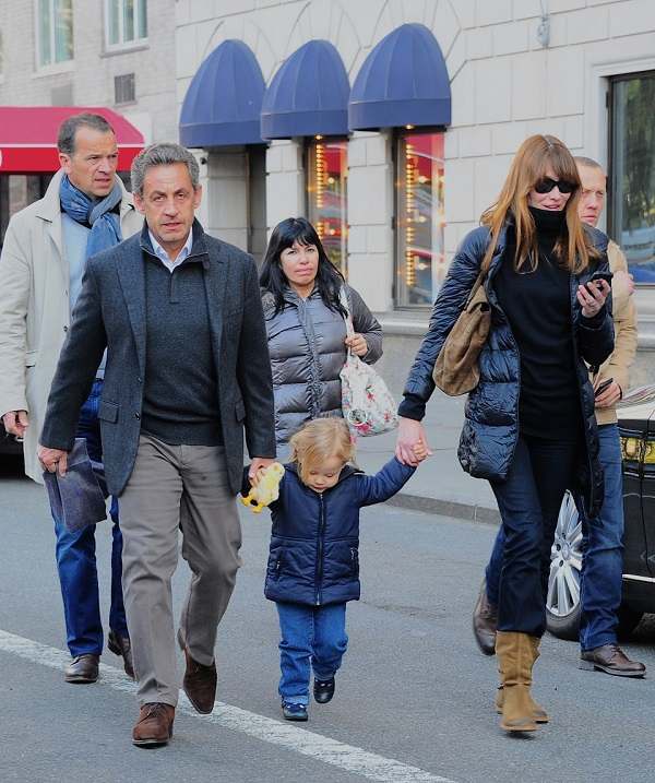 Nicolas Sarkozy and Carla Bruni enjoy a ride with little Giulia **USA, Canada, Australia ONLY**